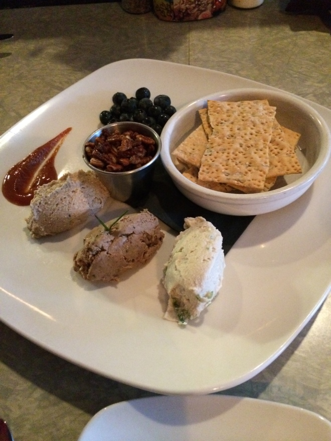 Tasting Plate: local crackers, spiced pecans, blueberries, peach jam, smoked cashew cream, tempeh pate, and cashew cream.